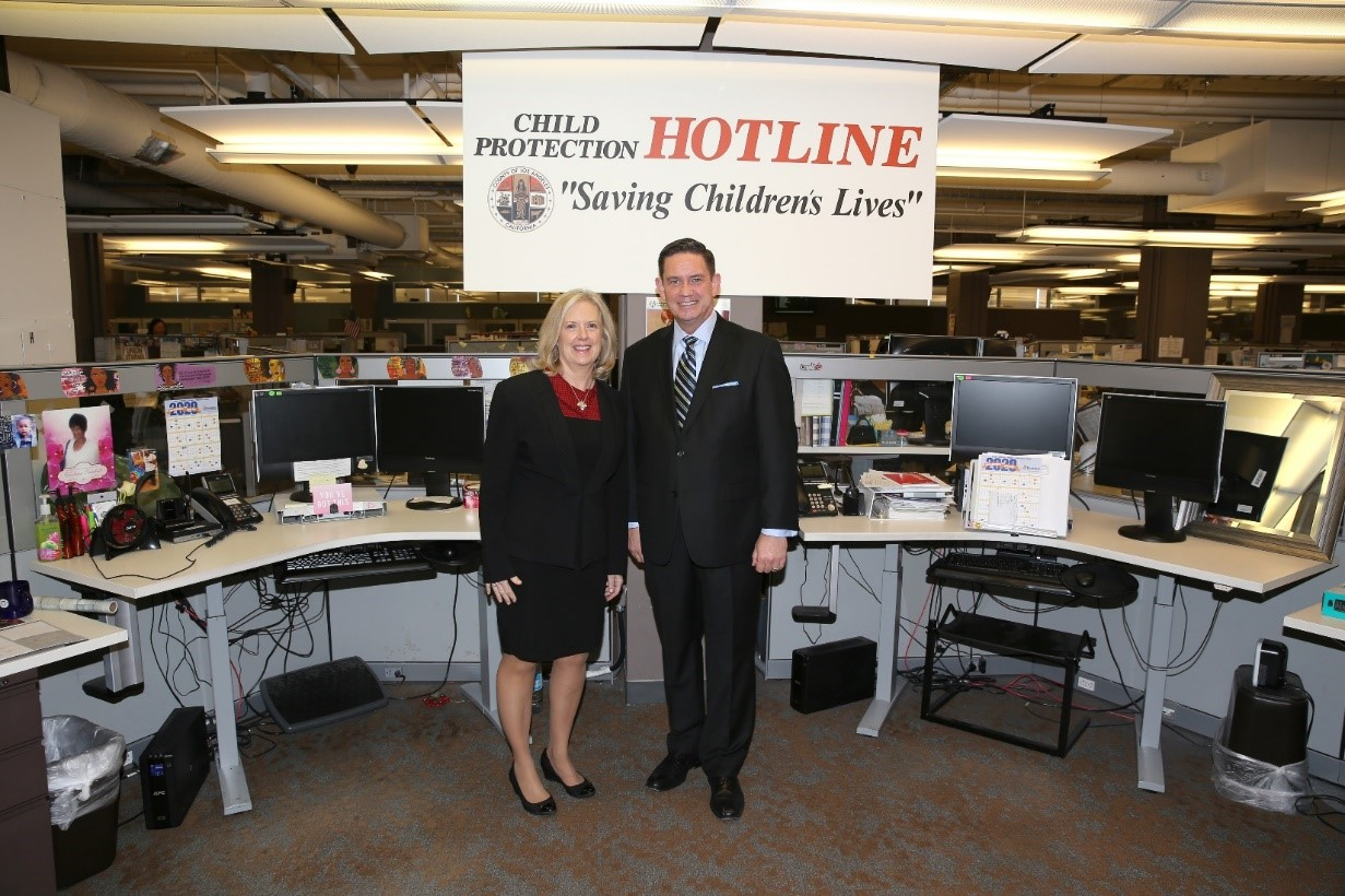 Assistant Secretary Lynn Johnson and Bobby Cagle (director, Los Angeles Department of Children and Family Services) in the county call center.