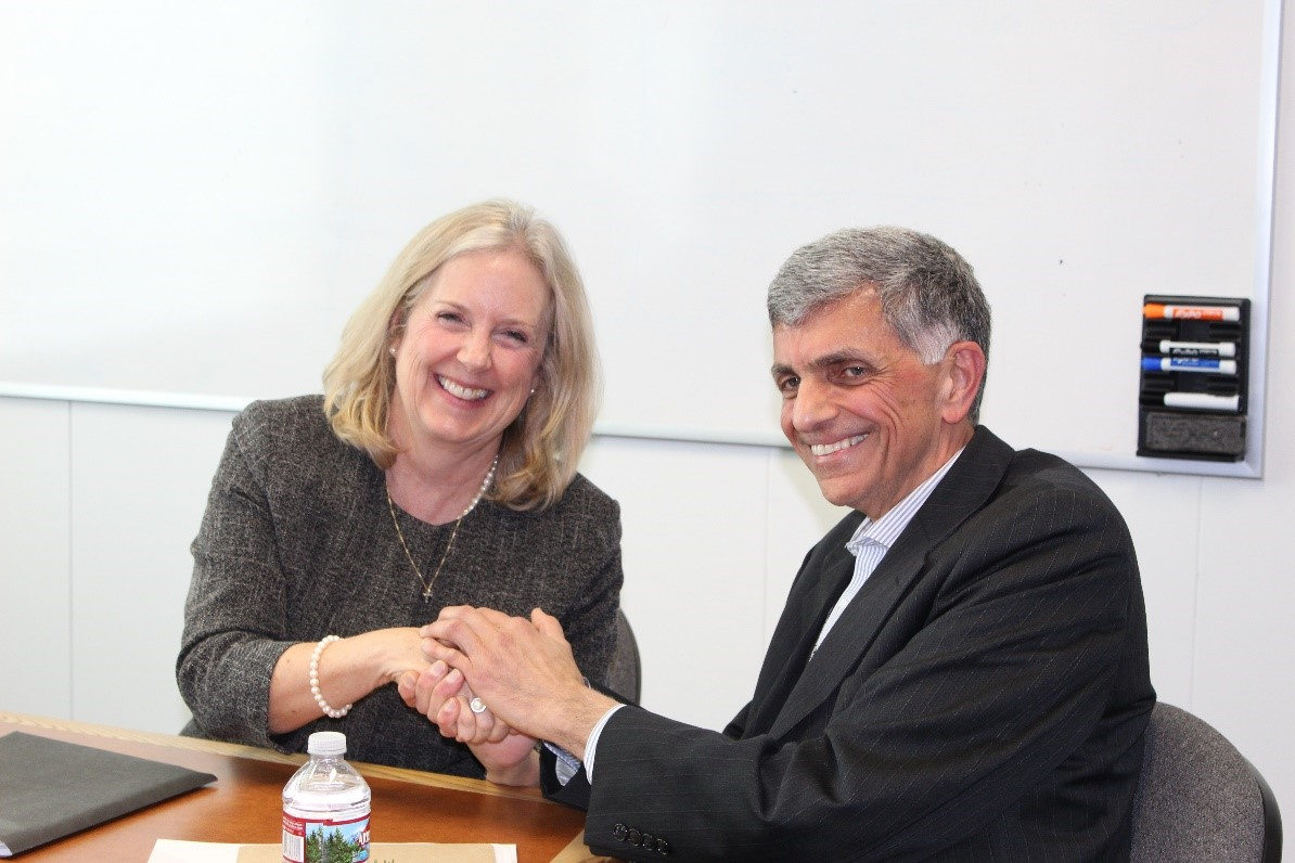Assistant Secretary Lynn Johnson and Fariborz Pakseresht (director, Oregon Department of Human Services)