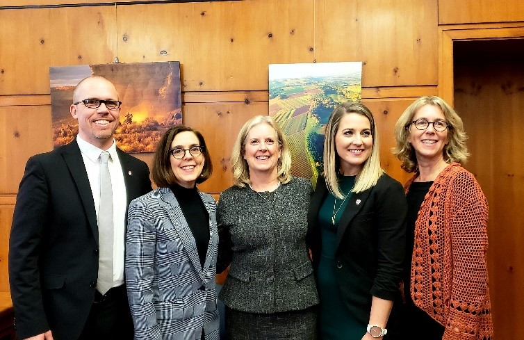 Ben Sand (chief executive officer, The Contingent), Governor Kate Brown, Assistant Secretary Lynn A. Johnson, Brooke Gray (director, Mobilization, The Contingent), and Representative Alissa Keny-Guyer