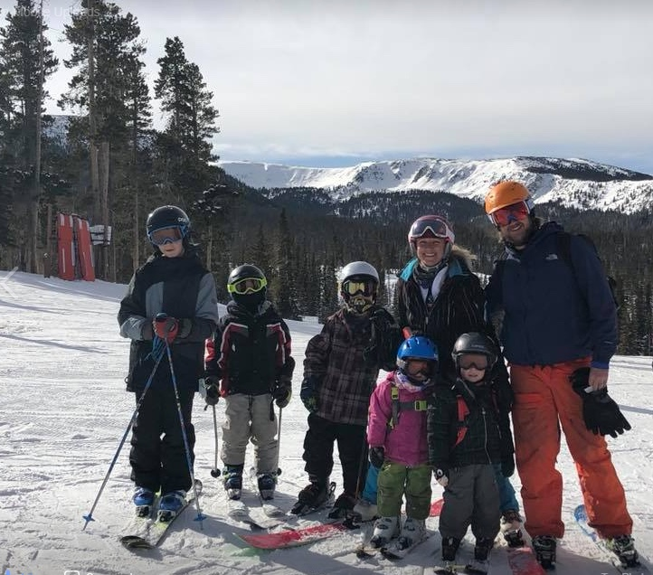 Mother, father, and their five children skiing