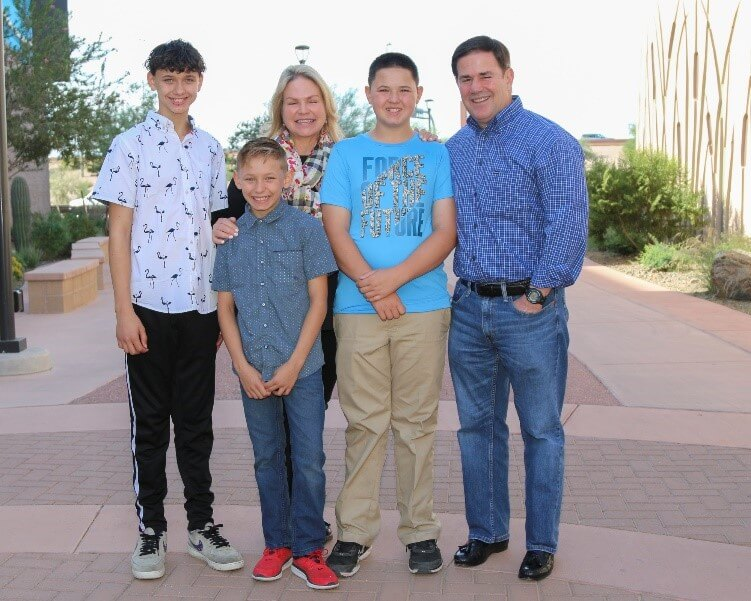 Governor and Mrs. Ducey with a sibling group waiting for adoption