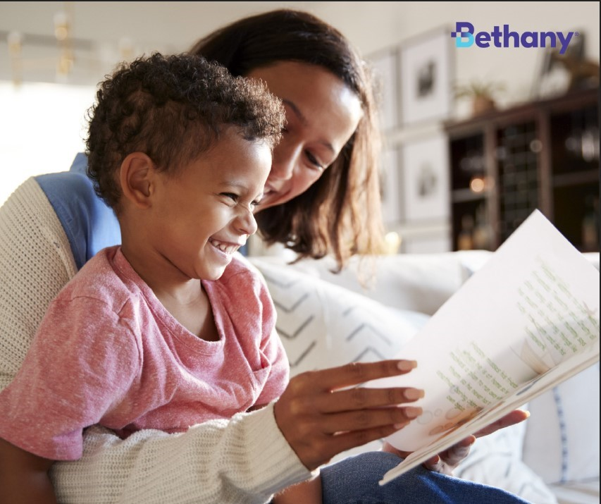 Picture of mother reading to her son. The Bethany logo is in the top right corner of the image.